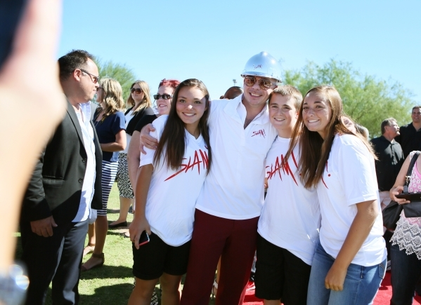 Rapper Pitbull, third from right, stands for a personal photo with students Katie Ballou, right; Nick Ballou, second from right; and Taylor Santos, fourth from right, during a groundbreaking cerem ...