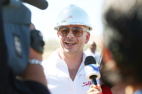 Rapper Pitbull speaks to the news media during a groundbreaking ceremony for Sports Leadership and Management (SLAM!) charter middle and high school Friday, Oct. 2, 2015, in Henderson. SLAM! is sl ...