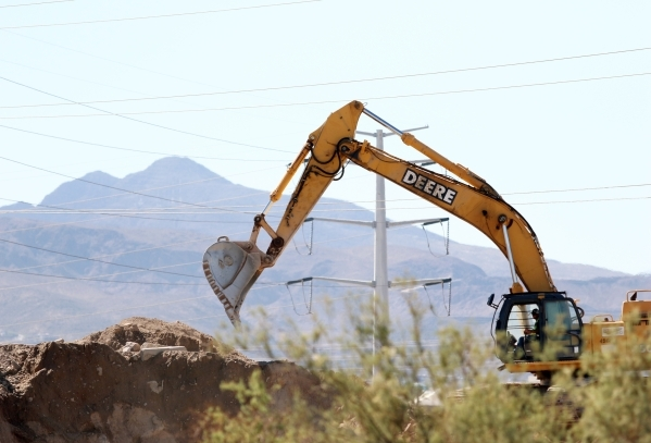 Construction is under way for Sports Leadership and Management (SLAM!) charter middle and high school Friday, Oct. 2, 2015, in Henderson. SLAM! is scheduled to open fall of 2016 and is rapper Pitb ...