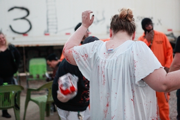 "Crystalena Nightengale stands for fake blood to be applied during a dress rehearsal at the ""Gates of Hell"" haunted house, which is one of the Trilogy of Terror haunted houses run by Frea ..."