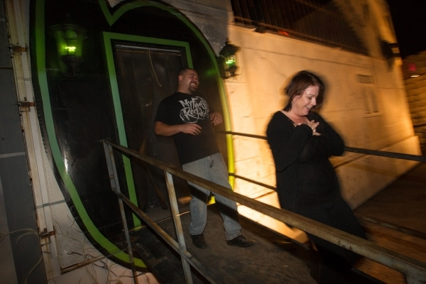 "Shannon and Russell Kizer exit the ""Gates of Hell"" haunted house, one of the Trilogy of Terror haunted houses run by Freakling Bros., at 4245 S. Grand Canyon Drive, in Las Vegas on Frida ..."