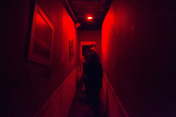 "People walk through the ""Gates of Hell"" haunted house, one of the Trilogy of Terror haunted houses run by Freakling Bros., at 4245 S. Grand Canyon Drive, in Las Vegas on Friday, Oct. 9,  ..."