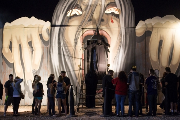 "People wait in line outside of ""The Coven of 13"" house, one of the Trilogy of Terror haunted houses run by Freakling Bros., at 4245 S. Grand Canyon Drive, in Las Vegas on Friday, Oct. 9, ..."