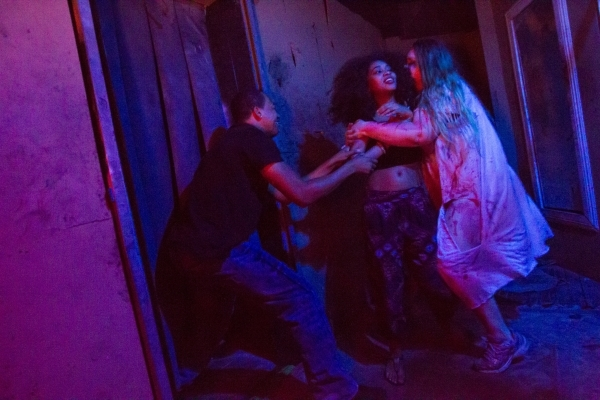 "Performer Crystalena Nightengale, right, scares people inside the ""Gates of Hell"" haunted house, one of the Trilogy of Terror haunted houses run by Freakling Bros., at 4245 S. Grand Cany ..."