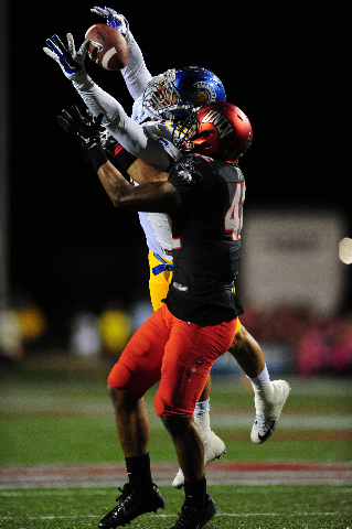 UNLV Rebels defensive back Peni Vea (42) breaks up a pass intended for San Jose State Spartans tight end Billy Freeman  (18) in the second quarter of their NCAA Football game against San Jose Stat ...