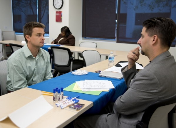 Greg Hawkins, left, answers questions during an interview with Andre Yates during a Clark County School District substitute teacher hiring event at The University of Phoenix building in Summerlin  ...