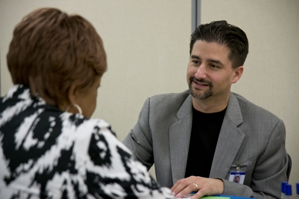 Juanita Green, left, answers questions during an interview with Andre Yates during a Clark County School District substitute teacher hiring event at The University of Phoenix building in Summerlin ...