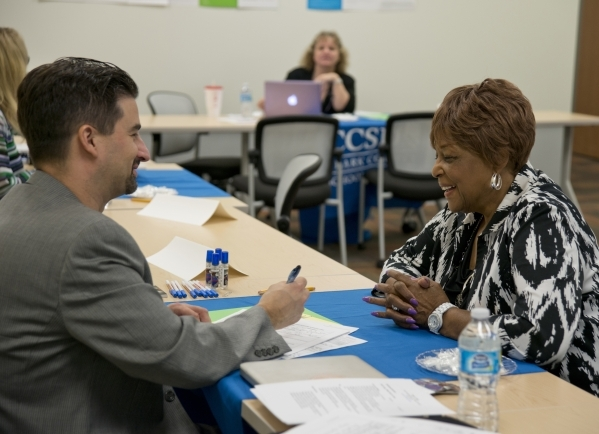 Juanita Green, right, answers questions during an interview with Andre Yates during a Clark County School District substitute teacher hiring event at The University of Phoenix building in Summerli ...