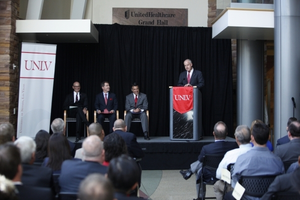 UNLV's vice president for research and economic development Thomas Piechota, from left, president Len Jessup, and Gov. Brian Sandoval, listen to Tesla vice president Diarmuid O'Connell ...