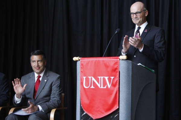 Gov. Brian Sandoval, left, is introduced by Thomas Piechota, vice president for research and economic development at UNLV, during a press conference at the UNLV Science and Engineering Building in ...