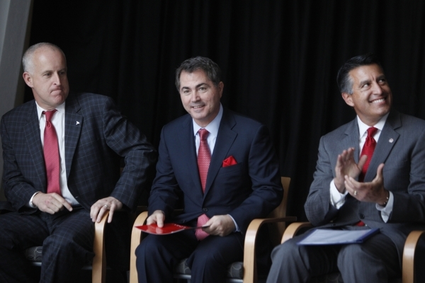 Diarmuid O'Connell, from left, vice president at Tesla, Len Jessup, president at UNLV, and Gov. Brian Sandoval, participate during a press conference at the UNLV Science and Engineering Buil ...