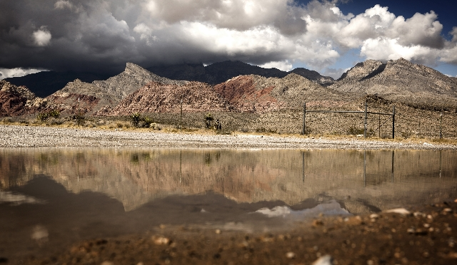A reflection of the Calico Basin and La Madre Mountains is seen from a road leading to the Red Rock Campground on Tuesday, Oct. 6,2015.  Jeff Scheid/ Las Vegas Review-Journal Follow @jlscheid
