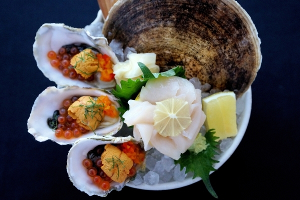 Live scallop sashimi and oysters topped with sea urchin and salmon roe at Other Mama. COURTESY PHOTO