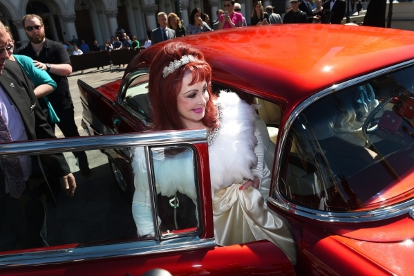 Naomi Judd gets in a 1957 Chevy after an appearance at the Venetian to publicize The Judds' nine-show residency Tuesday, Oct. 6, 2015. Sam Morris/Las Vegas News Bureau