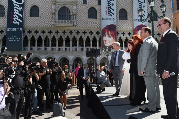 Naomi and Wynonna Judd pose for photos at the Venetian during an appearance to publicize their nine-show residency Tuesday, Oct. 6, 2015. Joining them are from left, senior vice President of AEG J ...