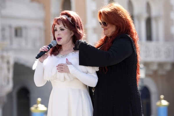 Wynonna Judd fixes her mother Naomi's hair as they make remarks after arriving at the Venetian to publicize their nine-show residency Tuesday, Oct. 6, 2015. Sam Morris/Las Vegas News Bureau