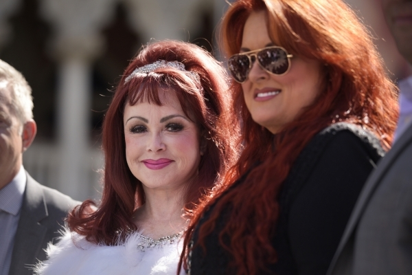 Naomi and Wynonna Judd pose for photos after arriving at the Venetian to publicize their nine-show residency Tuesday, Oct. 6, 2015. Sam Morris/Las Vegas News Bureau