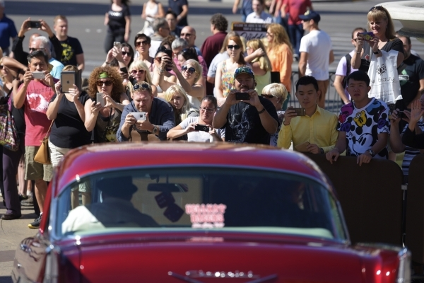 Bystanders take photos as Naomi and Wynonna Judd leave the Venetian after making an appearance to publicize their nine-show residency Tuesday, Oct. 6, 2015. Sam Morris/Las Vegas News Bureau