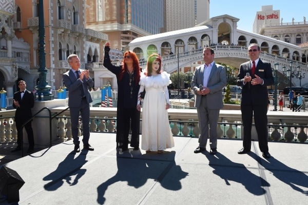 Naomi and Wynonna Judd arrive at the Venetian for an appearance to publicize their nine-show residency Tuesday, Oct. 6, 2015. Joining them are senior vice president of AEG John Nelson, left, vice  ...