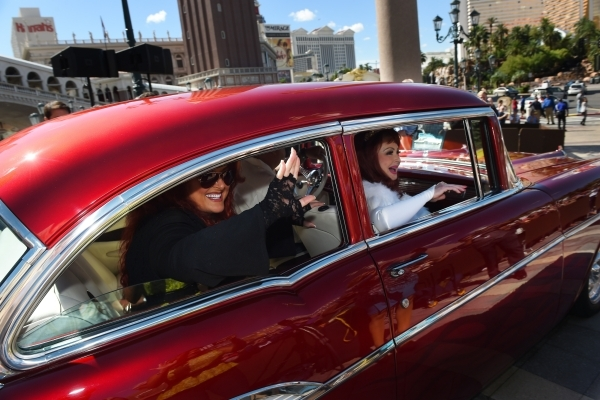Naomi and Wynonna Judd leave in a 1957 Chevy after an appearance at the Venetian to publicize their nine-show residency Tuesday, Oct. 6, 2015. Sam Morris/Las Vegas News Bureau