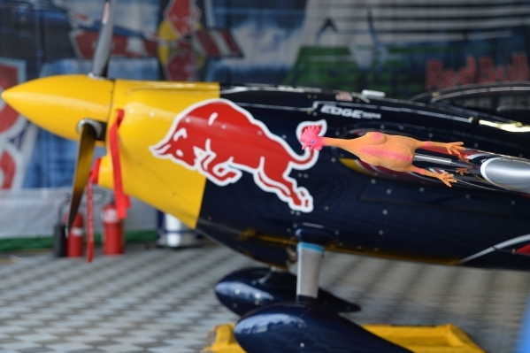 A rubber chicken covers a part of Hungarian pilot Peter Besenyei (91) while the plane sits its hangar before qualifying of the Red Bull Air Race World Championship Series race at the Las Vegas Mot ...