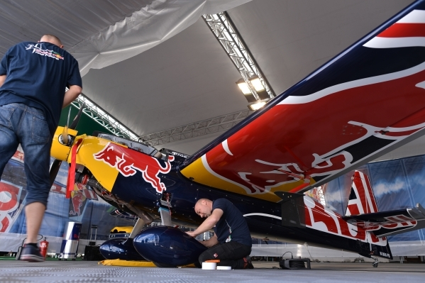 Mechanic's work on Hungarian pilot Peter Besenyei's (91) airplane before qualifying of the Red Bull Air Race World Championship Series race at the Las Vegas Motor Speedway on Saturday, ...