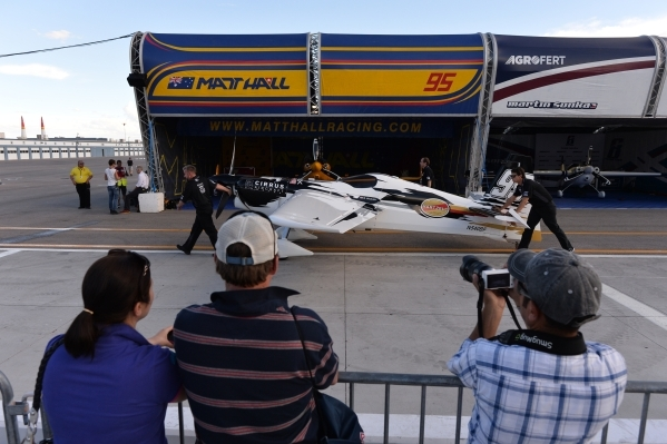Fans look on as American pilot Michael Goulian's plane is pushed to the staging area during the Red Bull Air Race World Championship Series race at the Las Vegas Motor Speedway on Saturday,  ...