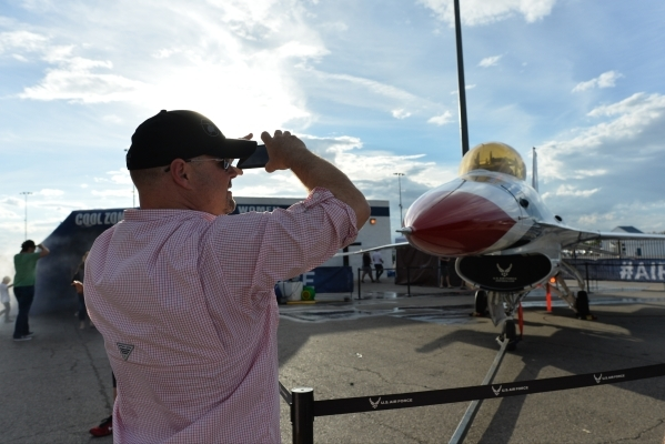 A man takes a photo of a United States Air Force Thunderbird during the Red Bull Air Race World Championship Series race at the Las Vegas Motor Speedway on Saturday, Oct. 17, 2015. Brett LeBlanc/L ...