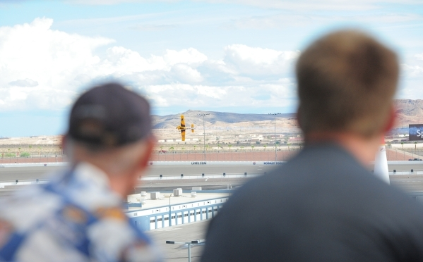 Fans look on as pilots make qualifying runs during the Red Bull Air Race World Championship Series race at the Las Vegas Motor Speedway on Saturday, Oct. 17, 2015. Brett LeBlanc/Las Vegas Review-J ...