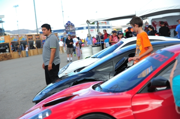 People pose for photos with exotic cars during the Red Bull Air Race World Championship Series race at the Las Vegas Motor Speedway on Saturday, Oct. 17, 2015. Brett LeBlanc/Las Vegas Review-Journ ...