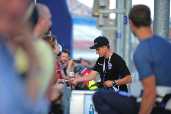 Canadian Pilot Pete Mcleod (84) signs autographs before a qualifying run during the Red Bull Air Race World Championship Series race at the Las Vegas Motor Speedway on Saturday, Oct. 17, 2015. Bre ...