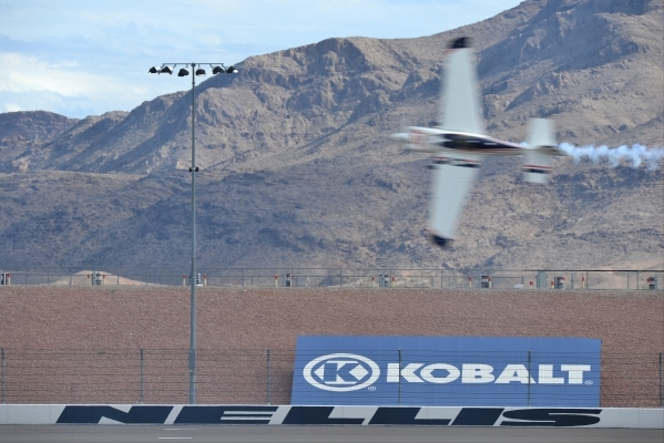 German pilot Matthias Dolderer (21) makes a qualifying run over the back stretch during the Red Bull Air Race World Championship Series race at the Las Vegas Motor Speedway on Saturday, Oct. 17, 2 ...