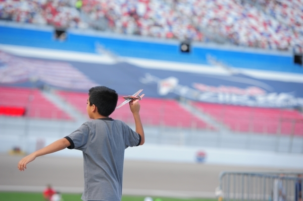 A child plays with a toy airplane during the Red Bull Air Race World Championship Series race at the Las Vegas Motor Speedway on Saturday, Oct. 17, 2015. Brett LeBlanc/Las Vegas Review-Journal Fol ...