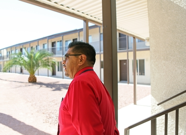 Juan Salinas, guest services coordinator for The Salvation Army, looks out over the transition apartments at The Salvation Army Tuesday, Oct. 13, 2015, in Las Vegas. Salinas said that the shelter  ...