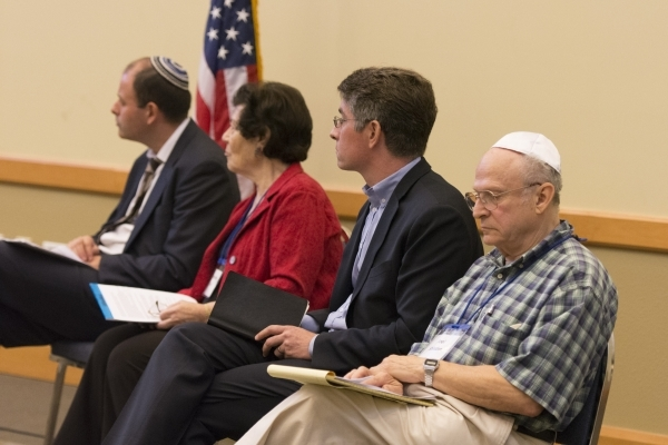 Panelists listen to Esther Finder speak during a discussion about the Syrian refugee crisis at Temple Sinai in Las Vegas Sunday, Oct. 11, 2015. From left are Rabbi Malcolm Cohen, Raymonde Fiol, Mi ...