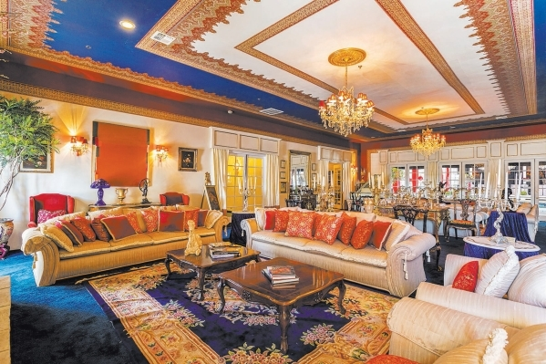 Hartland Mansion's living room featured high coffered gold-accented ceilings, chandeliers, statues of angels and displays of collectibles.  DAVID REISMAN