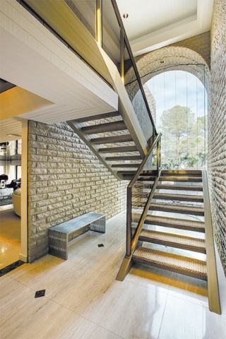 "Frank ""Lefty"" Rosenthal's former home has a bulletproof glass wall extending from ceiling to floor behind the staircase. COURTESY"