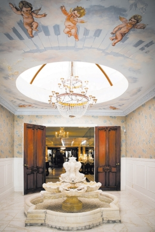 A fountain is near the first-floor master suite in the former Liberace mansion, which recently has been restored.  TONYA HARVEY