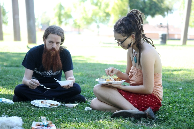 A man who declined to give his name, left, with Lauren Olson, share a meal prepared by Food Not Bombs at Huntridge Circle Park in Las Vegas on Sunday, Oct. 11, 2015. (Erik Verduzco/Las Vegas Revie ...