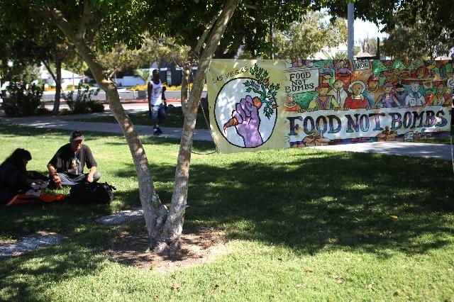 A Food Not Bombs banner hangs from trees at Huntridge Circle Park in Las Vegas on Sunday, Oct. 11, 2015. (Erik Verduzco/Las Vegas Review-Journal)