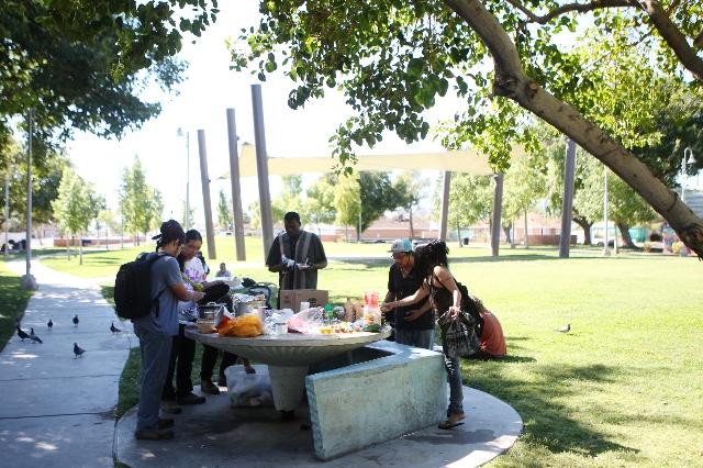 Food is served by volunteers with Food Not Bombs at Huntridge Circle Park in Las Vegas on Sunday, Oct. 11, 2015.(Erik Verduzco/Las Vegas Review-Journal)