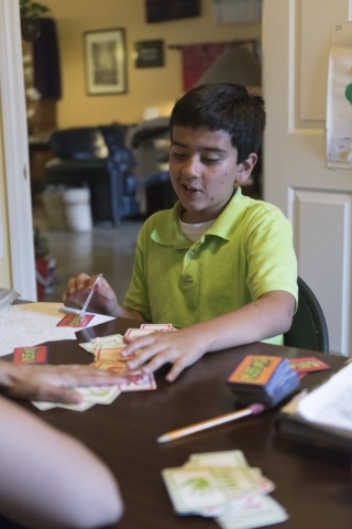 Eleven-year-old J.C. Hill works through an exercise during his therapy session with Roo Abdel-Al, a supervising consultant at The Lovass Center, at Hill's residence in Las Vegas Wednesday, O ...