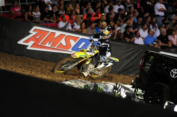 Monster Energy Cup AMA Supercross rider James Stewart of Haines City, FL (7) is seen riding in the arc part of the track during the first heat race of the Monster Energy Cup at Sam Boyd Stadium in ...