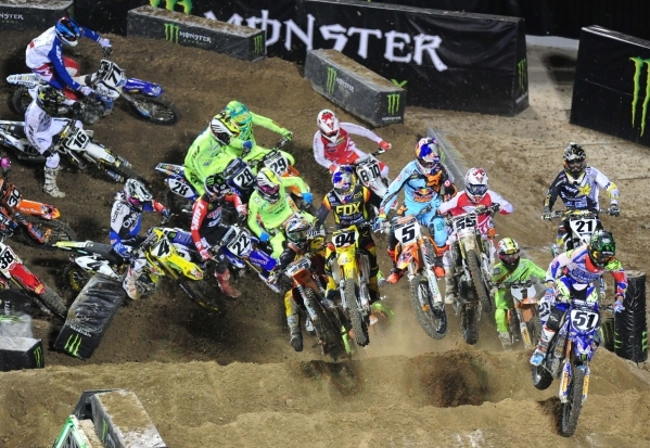 Monster Energy Cup AMA Supercross riders race over the first jump during the second heat race of the Monster Energy Cup at Sam Boyd Stadium in Henderson Sarturday, Oct. 17, 2015. Josh Holmberg/Las ...