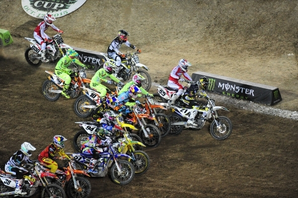 Monster Energy Cup AMA Supercross riders race into turn 1 during the second heat race of the Monster Energy Cup at Sam Boyd Stadium in Henderson Sarturday, Oct. 17, 2015. Josh Holmberg/Las Vegas R ...