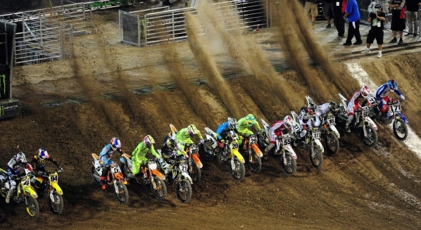 Monster Energy Cup AMA Supercross riders race into turn 1 during the second heat race of the Monster Energy Cup at Sam Boyd Stadium in Henderson Sarturday, Oct. 17, 2015. Josh Holmberg/Las Vegas N ...