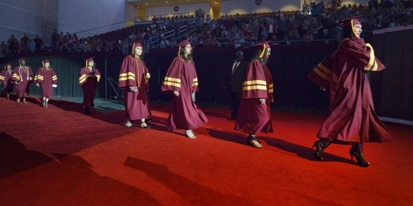 Students make their entrance during the graduation ceremony for Eldorado High School at the Orleans Arena at 4500 W. Tropicana Ave. in Las Vegas on Monday, June 8, 2015. (Bill Hughes/Las Vegas Rev ...