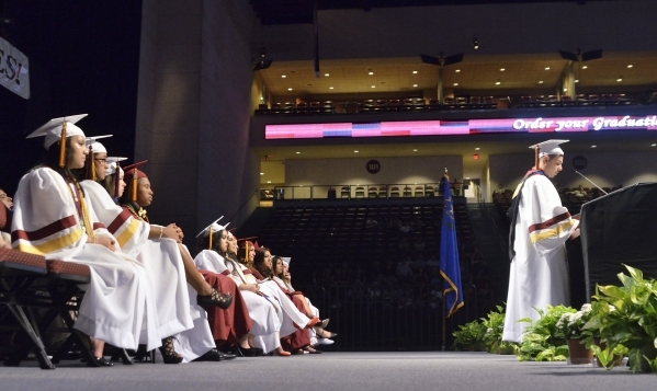 Valedictorian Aaron Crux-Castro, right, speaks during the graduation ceremony for Eldorado High School at the Orleans Arena at 4500 W. Tropicana Ave. in Las Vegas on Monday, June 8, 2015. (Bill Hu ...