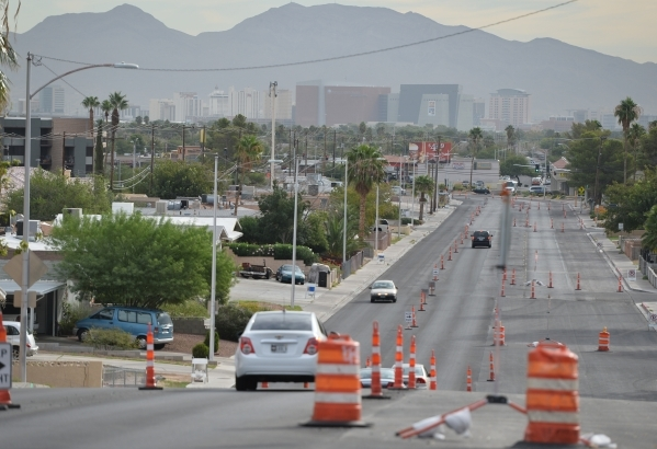 A car heads down the Decatur Fault scarp, Thursday, Oct. 15, 2015, on Alta Drive between Easy Street and Falcon Lane in Las Vegas. Brett Le Blanc/Las Vegas Review-Journal