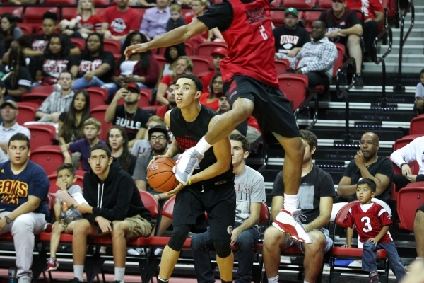 UNLV's Austin Starr (20) looks to shoot as Jerome Seagears (2) attempts to defend during the Scarlet and Gray scrimmage at the Thomas & Mack Center in Las Vegas on Thursday, Oct. 15, 201 ...